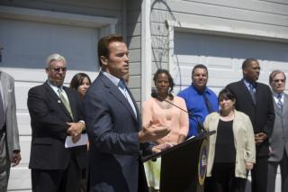 California Gov. Arnold Schwarzenegger (R) announcing a state program designed to help first-time homebuyers buy homes in neighborhoods hit hardest hit by the foreclosure crisis. California is one of several states establishing programs and enacting reforms to stave off foreclosures.
