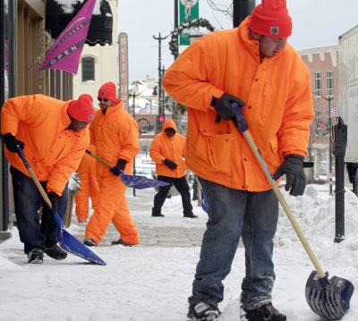 Racine County Jail inmates removing snow