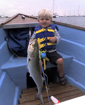Boy with bluefish