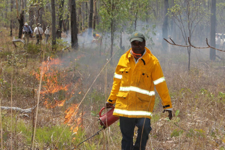 Indigenous Ranger Marcus Cameron applies a controlled burn in Warddeken Indigenous Protected Area.